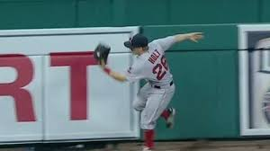 [first game in the outfield, first clutch catch by brock holt]