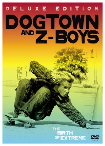 Poster for 'Dogtown and Z-Boys', photo of a male teen skating low to the ground as he turns around a cone.